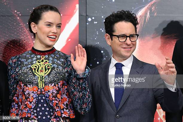 Actress Daisy Ridley and director JJ Abrams wave to the media during the press conference for 'Star Wars The Force Awakens' Japan premiere at the...