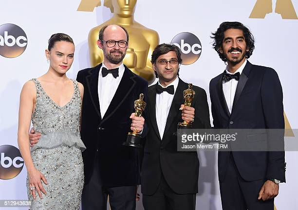 Actress Daisy Ridley, filmmakers James Gay-Rees, Asif Kapadia winners of the Best Documentary Feature award for 'Amy,' and Dev Patel pose in the...