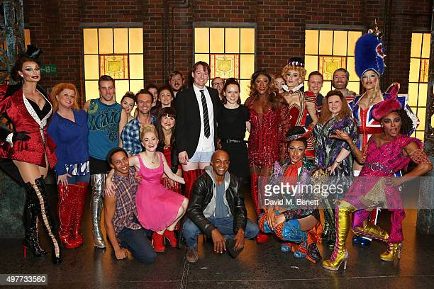 Actress Daisy Ridley poses onstage with cast members including Killian Donnelly and Matt Henry following a performance of 'Kinky Boots' at the...