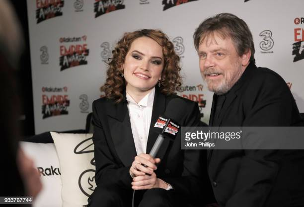 Actress Daisy Ridley winner of the Best Actress award and actor Mark Hamill winner of the Empire Icon award are interviewed in the winners room at...