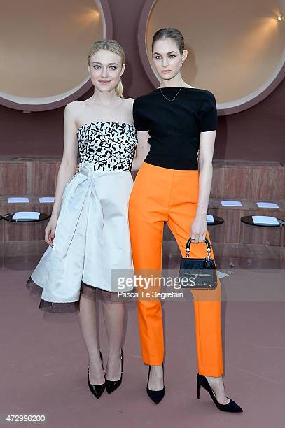 Actress Dakota Fanning and Laura Love attend the Dior Croisiere 2016 at Palais Bulle on May 11 2015 in Theoule sur Mer France