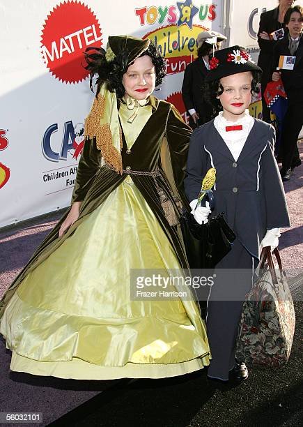 Actress Dakota Fanning and sister Elle Fanning attend the 12th Annual Dream Halloween Fundraiser held at Santa Monica Airport October 29 2005 in...