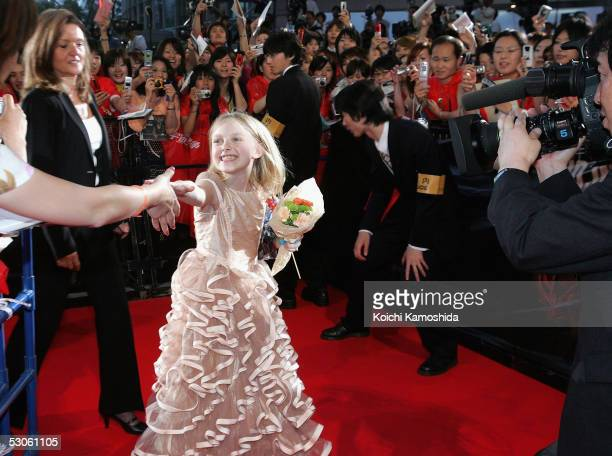 Actress Dakota Fanning arrives at the Japan Premiere of 'War of the Worlds' on June 13 2005 in Tokyo Japan The film will open on June 29...