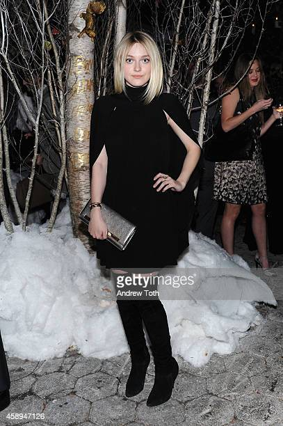 Actress Dakota Fanning attends Barneys New York 'Baz Dazzled' holiday window unveiling dinner at Central Park Zoo on November 13 2014 in New York City