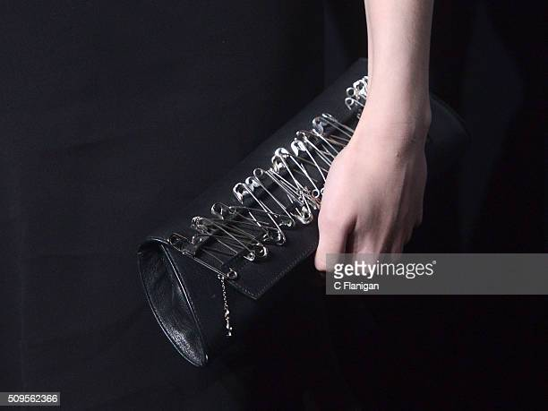 Actress Dakota Fanning Purse Detail arrives at SAINT LAURENT At The Palladium at Hollywood Palladium on February 10 2016 in Los Angeles California