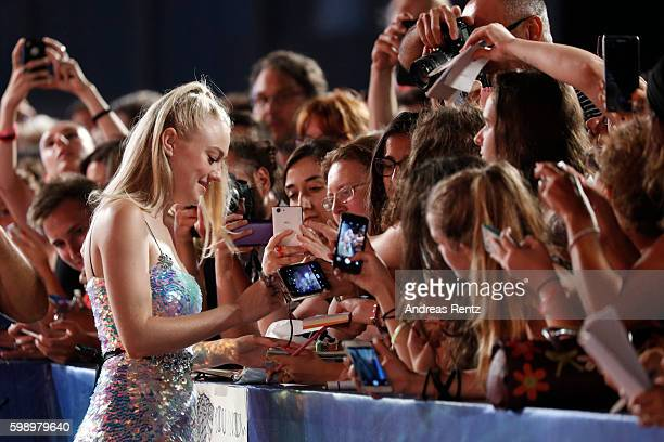 Actress Dakota Fanning signs autographs at the premiere of 'Brimstone' during the 73rd Venice Film Festival at Sala Grande on September 3 2016 in...
