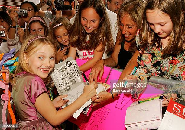 """Actress Dakota Fanning signs autographs for fans at the DreamWorks premiere of """"Dreamer: Inspired By A True Story"""" at Roy Thompson Hall during the..."""