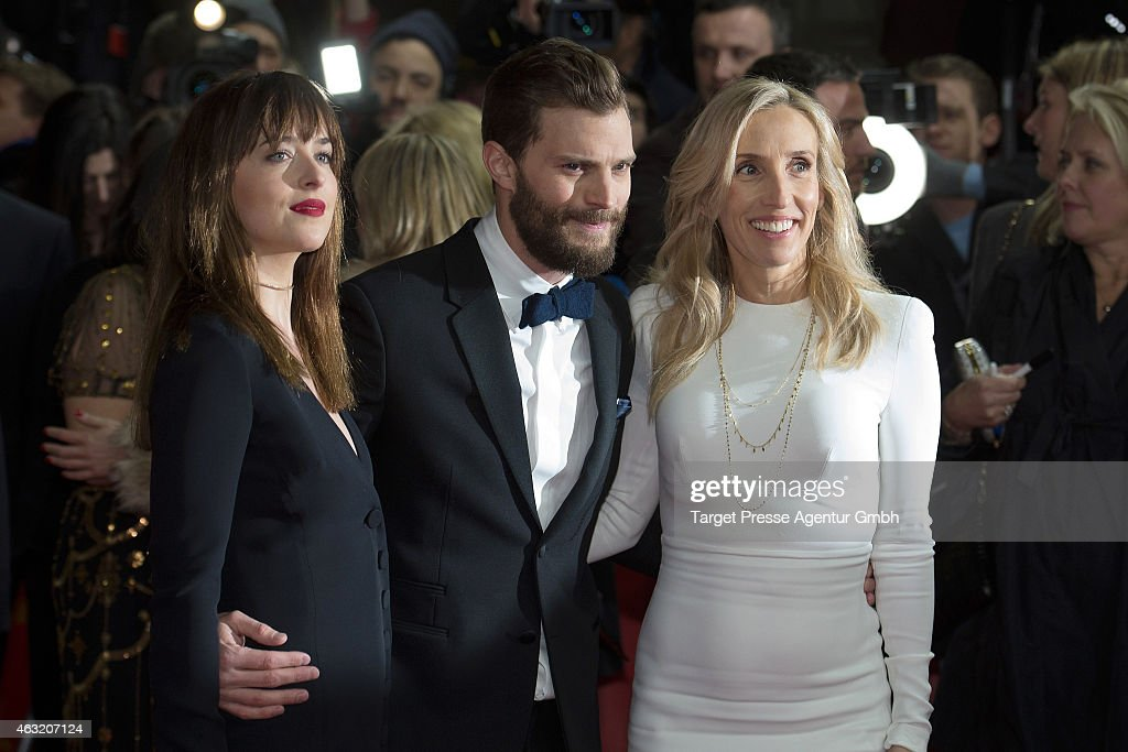 Actress Dakota Johnson, actor Jamie Dornan and director Sam Taylor-Johnson attend the 'Fifty Shades of Grey' premiere during the 65th Berlinale International Film Festival at Zoo Palast on February 11, 2015 in Berlin, Germany.