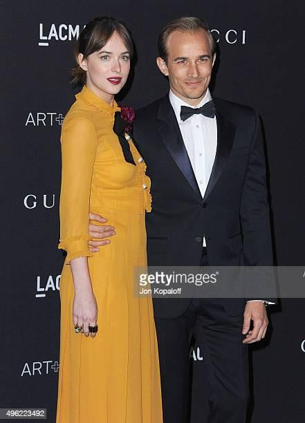 Actress Dakota Johnson and actor Jesse Johnson attend the LACMA Art Film Gala honoring Alejandro Gonzalez Iarritu and James Turrell and presented by...