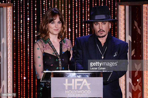 Actress Dakota Johnson and actor Johnny Depp speak onstage during the 19th Annual Hollywood Film Awards at The Beverly Hilton Hotel on November 1...