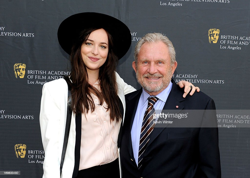 Actress Dakota Johnson (L) and BAFTA Chairman Gary Dartnall arrive at the 26th Annual BAFTA LA Garden Party at the British Consul-General's official residence on June 2, 2013 in Los Angeles, California.