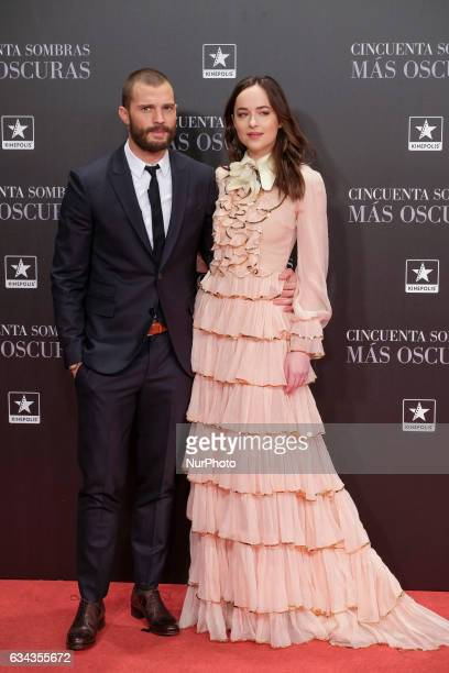 US actress Dakota Johnson and British actor Jamie Dorman pose at their arrival to the presentation of 'Fifty Shades Darker' held at Kinepolis cinema...