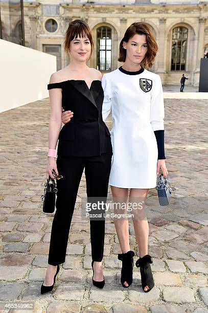 Actress Dakota Johnson and Hanneli Mustaparta attend the Christian Dior show as part of the Paris Fashion Week Womenswear Fall/Winter 2015/2016 on...