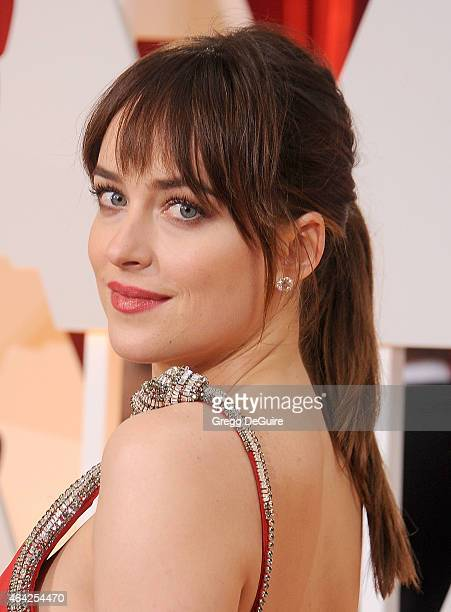 Actress Dakota Johnson arrives at the 87th Annual Academy Awards at Hollywood Highland Center on February 22 2015 in Hollywood California