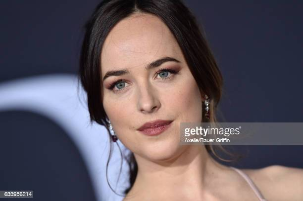 Actress Dakota Johnson arrives at the premiere of Universal Pictures' 'Fifty Shades Darker' at The Theatre at Ace Hotel on February 2 2017 in Los...