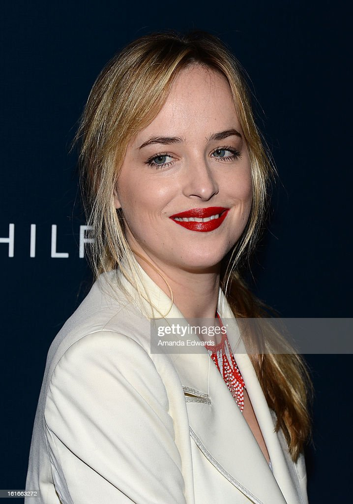 Actress Dakota Johnson arrives at the Tommy Hilfiger West Coast Flagship Grand Opening Event at Tommy Hilfiger West Hollywood on February 13, 2013 in West Hollywood, California.