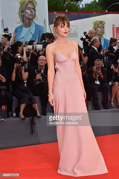 US actress Dakota Johnson arrives for the screening of the movie 'Black Mass' presented out of competition at the 72nd Venice International Film...