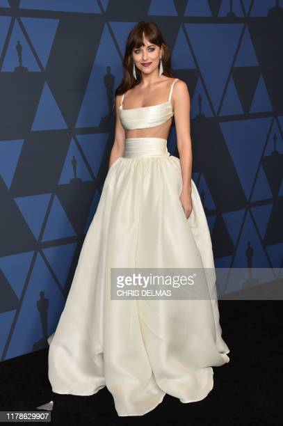 US actress Dakota Johnson arrives to attend the 11th Annual Governors Awards gala hosted by the Academy of Motion Picture Arts and Sciences at the...