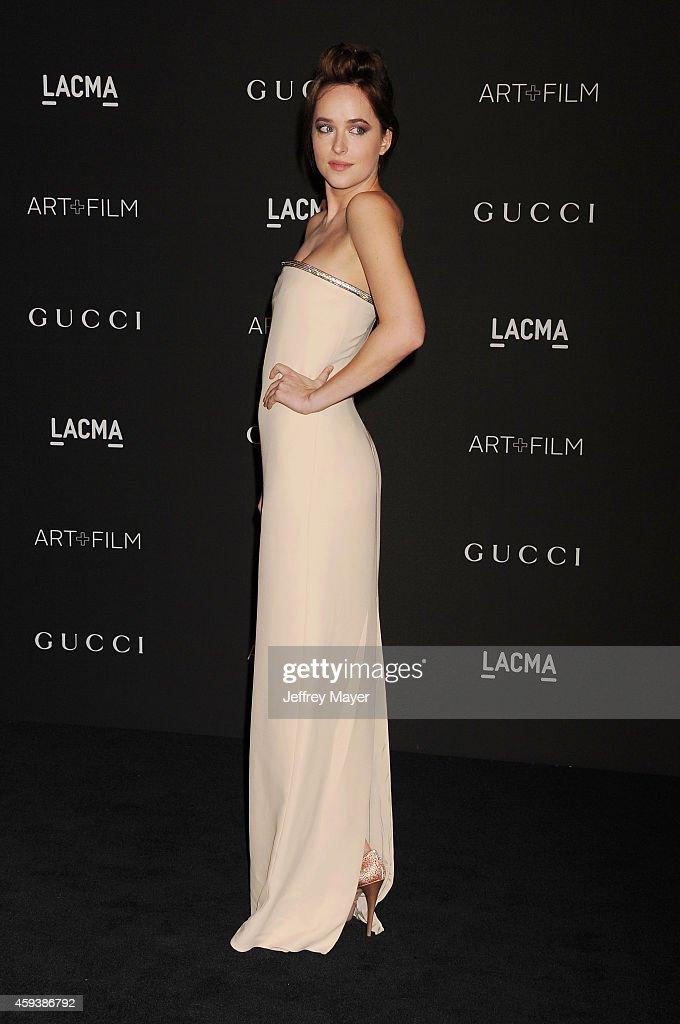 Actress Dakota Johnson attends the 2014 LACMA Art + Film Gala honoring Barbara Kruger and Quentin Tarantino presented by Gucci at LACMA on November 1, 2014 in Los Angeles, California.