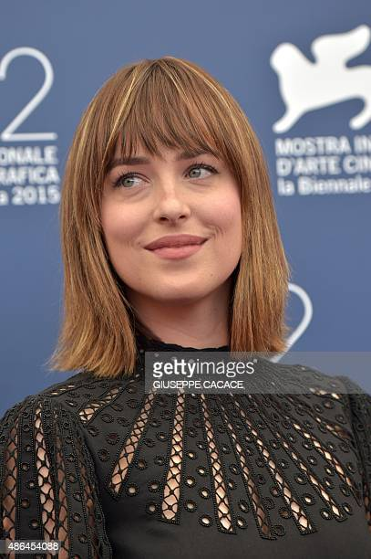US actress Dakota Johnson poses during the photocall of the movie 'Black Mass' presented out of competition at the 72nd Venice International Film...