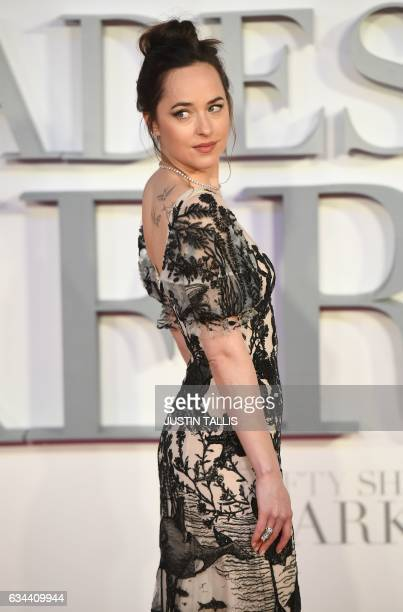 US actress Dakota Johnson poses on the red carpet upon arrival at the UK premiere of Fifty Shades Darker in London on February 9 2017 / AFP / Justin...