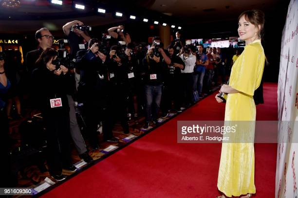 Actress Dakota Johnson, recipient of the Female Star of the Year award, attends the CinemaCon Big Screen Achievement Awards brought to you by the...