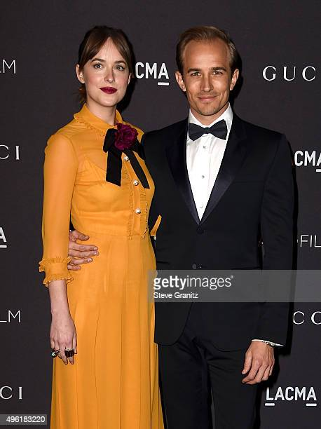Actress Dakota Johnson wearing Gucci and actor Jesse Johnson attend LACMA 2015 ArtFilm Gala Honoring James Turrell and Alejandro G Iñárritu Presented...