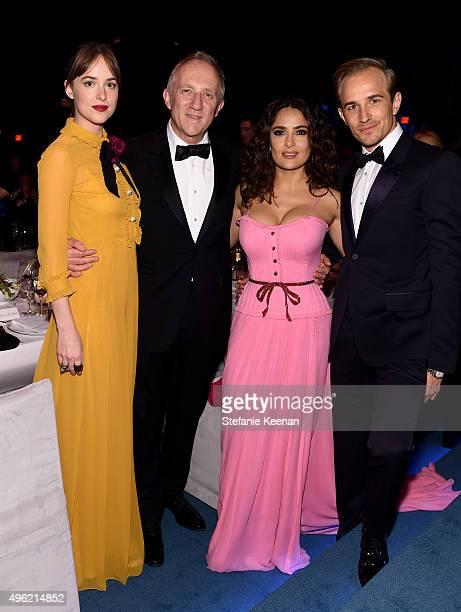 Actress Dakota Johnson wearing Gucci businessman FrancoisHenri Pinault actress Salma Hayek wearing Gucci and actor Jesse Johnson attend LACMA 2015...