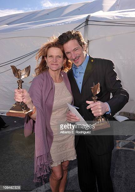 Actress Dale Dickey winner of the Best Supporting Female award for 'Winter's Bone' and actor John Hawkes winner of the Best Supporting Male award for...