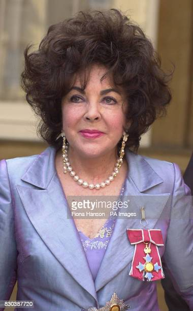 Actress Dame Elizabeth Taylor after she received the honour of Dame Commander of the Order of the British Empire from Queen Elizabeth II at at...