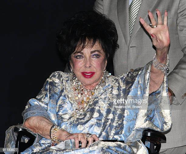 Actress Dame Elizabeth Taylor attends the 27th annual Macy's Passport benefit at the Barker Hangar on September 24 2009 in Santa Monica California