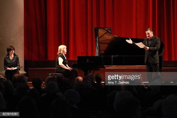Actress Dame Harriet Walter as Clara Schumann and actor Henry Goodman as Robert Schumann as pianist Lucy Parham plays at a Steinway piano during a...