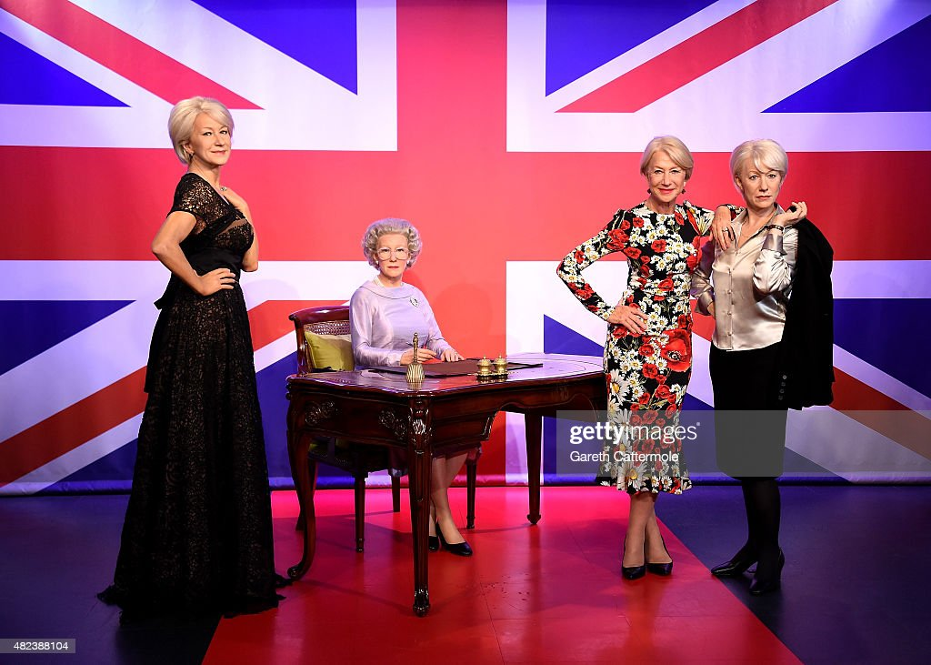 Actress Dame Helen Mirren (2nd R) meets her 3 wax figures at Madame Tussauds to mark here 70th birthday on July 30, 2015 in London, England.