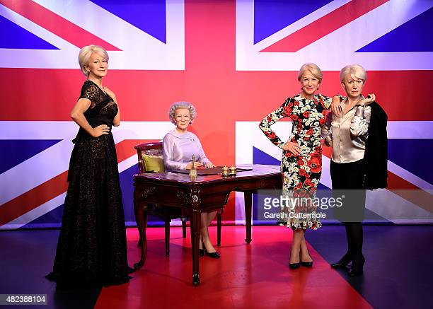Actress Dame Helen Mirren meets her 3 wax figures at Madame Tussauds to mark here 70th birthday on July 30 2015 in London England