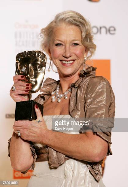 Actress Dame Helen Mirren poses with the award for Best Actress in a Leading Role for The Queen in the awards room at The Orange British Academy Film...