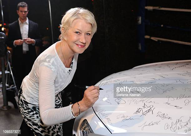 """Actress Dame Helen Mirren signs a Chrysler 300 as Vanity Fair Campaign Hollywood 2011 kicks off with Chrysler Celebrating """"The Fighter"""" held at the..."""