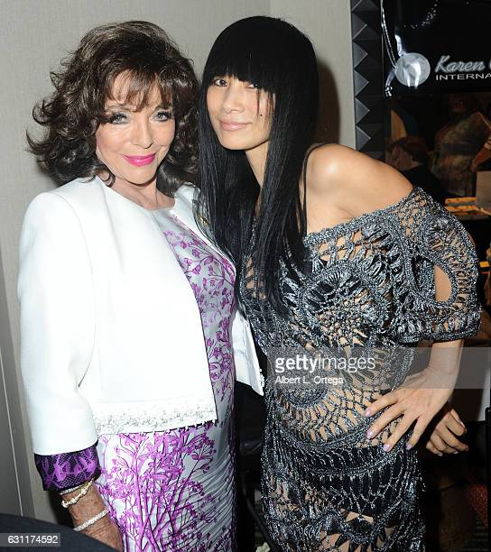 Actress Dame Joan Collins and actress Bai Ling attend The Hollywood Show held at The Westin Los Angeles Airport on January 7 2017 in Los Angeles...