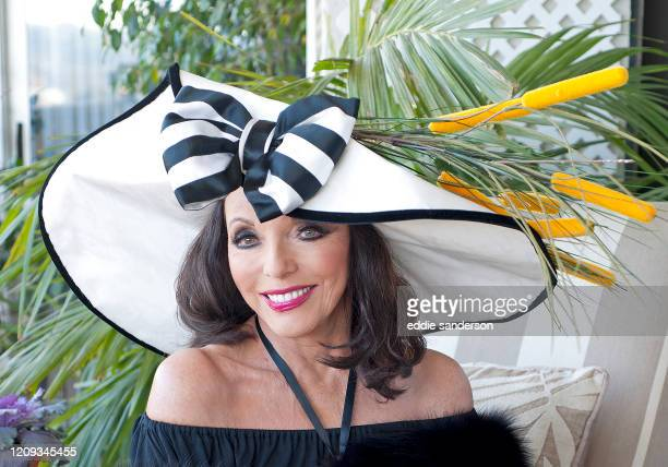 Actress Dame Joan Collins sits on the balcony of her West Hollywood California penthouse apartment shortly after being awarded a dame hood from...