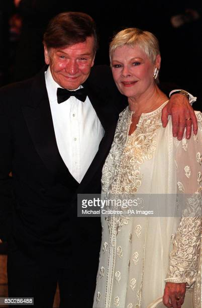 Actress Dame Judi Dench and her husband actor Michael Williams arrive at the European Charity Premiere of The World Is Not Enough which stars Pierce...