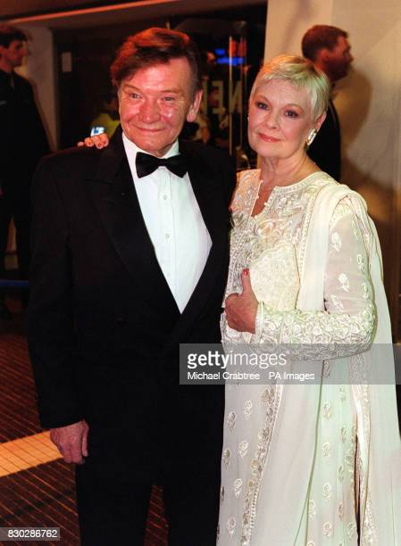 Actress Dame Judi Dench and her husband actor Michael Williams arrive at the European Charity Premiere of the James Bond film The World Is Not Enough...
