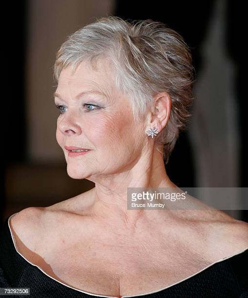 Actress Dame Judi Dench arrives at the Orange British Academy Film Awards at the Royal Opera House on February 11 2007 in London England