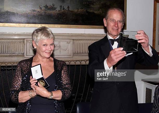 Actress Dame Judi Dench being awarded the 2000 Benjamin Franklin Medal by Prince Philip on behalf of the the RSA for her TransAtlantic contribution...