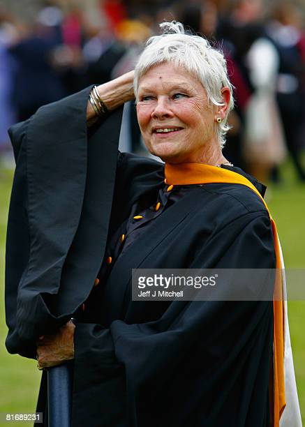 Actress Dame Judi Dench poses with her diploma after being awarded a Doctor of Letters by Saint Andrews University on June 24 2008 in Saint Andrews...