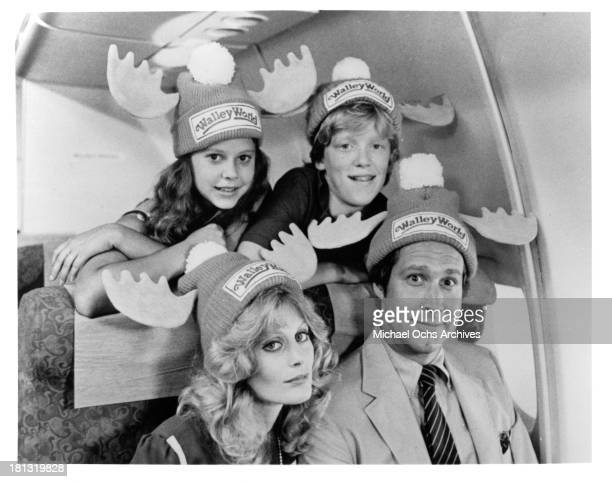 Actress Dana Barron actor Anthony Michael Hall actress Beverly D'Angelo and actor Chevy Chase pose for the Warner Bros movie National Lampoon's...