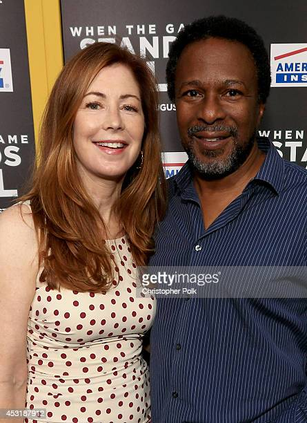 Actress Dana Delany and director Thomas Carter attend the premiere of Tri Star Pictures' 'When The Game Stands Tall' at ArcLight Cinemas on August 4...