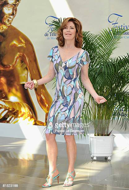 Actress Dana Delany dances as she attends a photocall promoting the television series Desperate Housewives on the fourth day of the 2008 Monte Carlo...