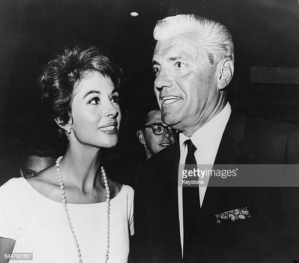 Actress Dana Wynter and celebrity attorney Greg Bautzer arriving at the premiere of the film 'Come September' Hollywood CA August 29th 1961