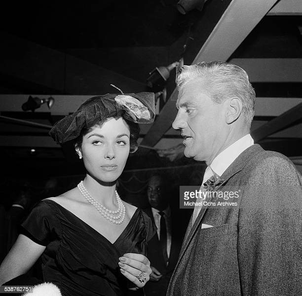 Actress Dana Wynter and husband attorney Greg Bautzer attend a party in Los AngelesCA