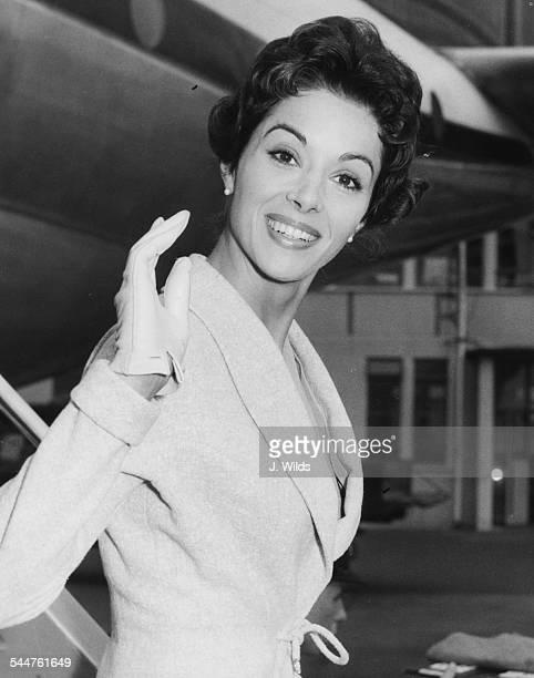 Actress Dana Wynter waving as she arrives at London Airport September 17th 1958