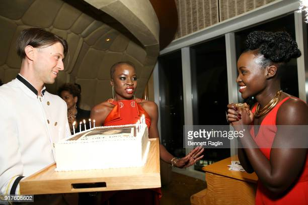 Actress Danai Gurira blows out the candles on her birthday cake as Lupita Nyong'o looks on during the DANAI x One x Love Our Girls celebration at The...